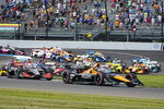 Pato O'Ward, of Mexico, (5) leads the field on the start of the IndyCar auto race at Indianapolis Motor Speedway in Indianapolis, Saturday, Aug. 14, 2021. (AP Photo/Michael Conroy)