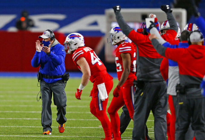Buffalo Bills head coach Sean McDermott, left, celebrates during the first half of an NFL football game against the Pittsburgh Steelers in Orchard Park, N.Y., Sunday, Dec. 13, 2020. The Bills won 26-15. (AP Photo/Jeffrey T. Barnes )