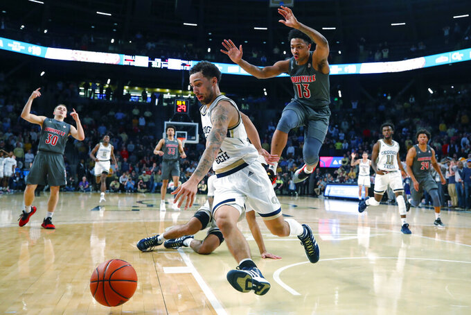 Georgia Tech guard Jose Alvarado (10) comes up with the ball late in the second half of an NCAA college basketball game against Louisville in Atlanta, Wednesday, Feb. 12, 2020. (AP Photo/Todd Kirkland)
