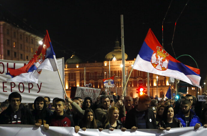 People march during a protest in Belgrade, Serbia, Saturday, March 16, 2019. Thousands of people have rallied in Serbia's capital for 15th week in a row against populist President Aleksandar Vucic and his government. (AP Photo/Darko Vojinovic)