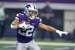 Kansas State running back Deuce Vaughn (22) carries the ball in the first half of an NCAA college football game against Stanford in Arlington, Texas, Saturday, Sept. 4, 2021. (AP Photo/Tony Gutierrez)