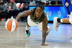 Seattle Storm guard Jewell Loyd passes the ball during the first half against the Connecticut Sun in the Commissioner's Cup WNBA basketball game Thursday, Aug. 12, 2021, in Phoenix. (AP Photo/Matt York)