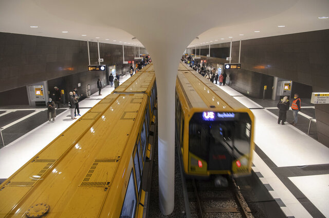 Trains of the subway line 5 stay at new station Rotes Rathaus in Berlin, Germany, Friday, Dec. 4, 2020. Berlin has opened a long-awaited new subway section that tunnels under one of the city's best-known boulevards and improves transport links from the German capital's central railway station. The new part connect the Alexanderplatz square with the Brandenburg Gate. (Paul Zinken/dpa via AP)