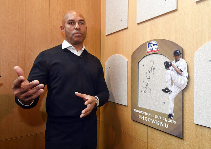 Baseball Hall of Fame inductee Mariano Rivera speaks after signing the backer board where his plaque will hang while visiting the National Baseball Hall of Fame and Museum, Friday, Feb. 1, 2019, in Cooperstown, N.Y. The former New York Yankees closer will be inducted on July 21. (AP Photo/Hans Pennink)