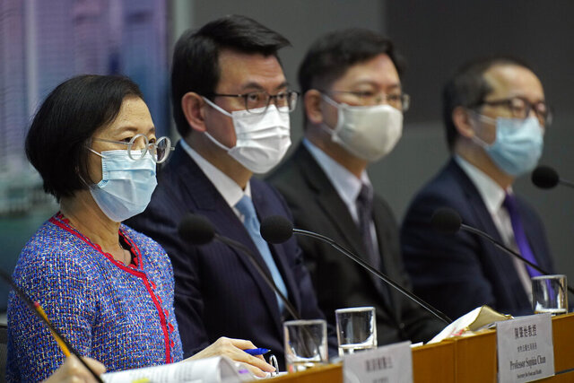 Secretary for Food and Health, Sophia Chan, left, and other officials attend a press conference in Hong Kong Wednesday, Nov. 11, 2020. Hong Kong and Singapore will launch an air travel bubble at the end of the month, allowing travelers in both cities to visit the other without having to serve quarantine. Under the arrangements, travelers will have to take a total of three tests to prove that they do not have the coronavirus, and must travel on designated flights between the two cities. (AP Photo/Vincent Yu)