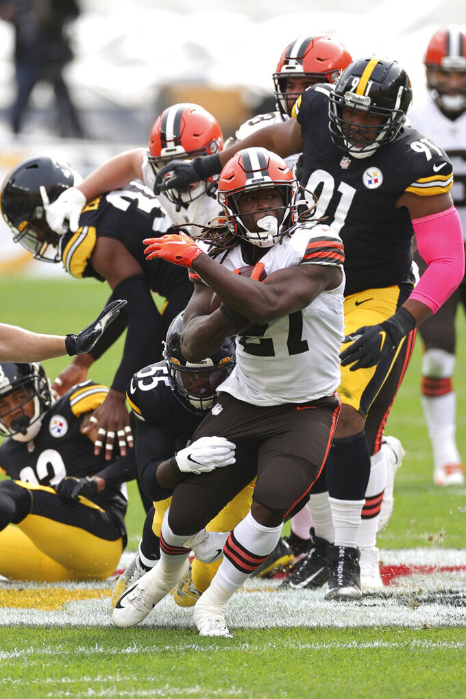 Cleveland Browns running back Kareem Hunt (27) carries the ball in an NFL game against the Pittsburgh Steelers, Sunday, Oct. 18, 2020, in Pittsburgh. The Steelers defeated the Browns 38-7. (Margaret Bowles via AP)