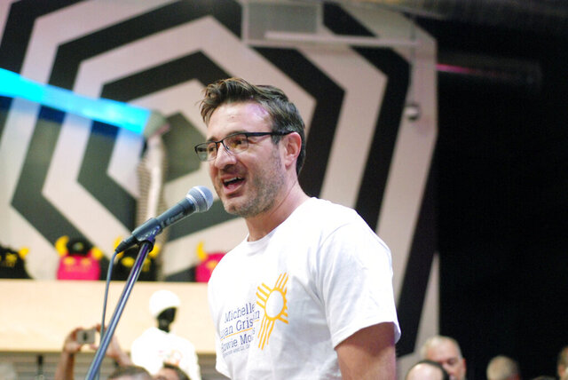 FILE - In this Nov. 2, 2018 photo Vince Kadlubek, co-founder and board member of the offbeat arts and entertainment startup company Meow Wolf, speaks at a Democratic political rally at a Meow Wolf venue in Santa Fe, N.M. After the Great Recession pummeled the economy in 2008-2009, venture investment in New Mexico ground to a near halt as struggling venture-backed startups crashed and burned and investors hunkered down to await better times. Startups hope support systems today prevent this. (AP Photo/Morgan Lee, File)