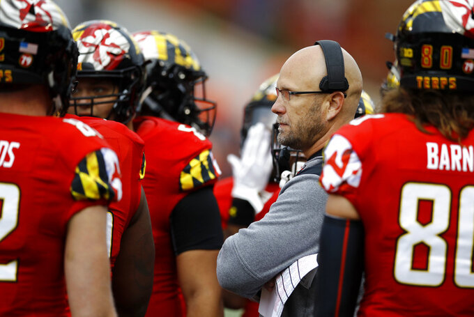 FILE - In this Oct. 27, 2018, file photo, Maryland interim coach Matt Canada speaks with players during a timeout in the first half of the team's NCAA college football game against Illinois in College Park, Md. Maryland hosts Michigan State on Saturday. Maryland is within a victory of becoming bowl eligible. (AP Photo/Patrick Semansky, File)