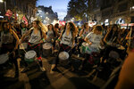 Women play drums during a protest against gender violence in Buenos Aires, Argentina, Monday, June 3, 2019. The grassroots movement