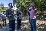 DELETES REFERENCE TO SOLANO COUNTY - California Gov. Gavin Newsom tosses a walnut as he tours Sierra Orchards walnut farm with owner Craig McNamara, right, in Winters, Calif., Wednesday, Oct. 7, 2020. Newsom signed an executive order Wednesday to protect nearly a third of California's land and coastal waters in his latest effort to fight climate change that he has blamed for recent record-breaking wildfires. (Renée C. Byer/The Sacramento Bee via AP, Pool)