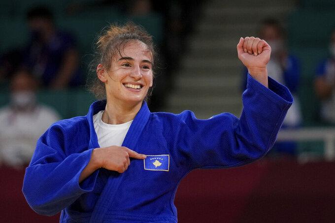 Nora Gjakova of Kosovo reacts during her women's -57kg semifinal judo match against Tsukasa Yoshida of Japan, at the 2020 Summer Olympics in Tokyo, Japan, Monday, July 26, 2021. (AP Photo/Vincent Thian)