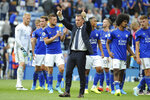 Leicester's manager Brendan Rodgers gives the thumbs-up to the fans next to some of his players at the end of the English Premier League soccer match between Leicester City and Wolverhampton Wanderers at the King Power Stadium in Leicester, England, Sunday, Aug.11, 2019. (AP Photo/Rui Vieira)