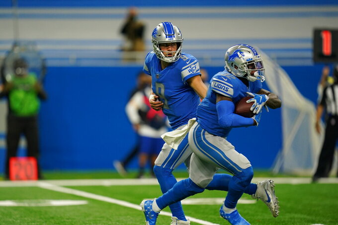 Detroit Lions quarterback Matthew Stafford (9) handing off ball to Detroit Lions running back D'Andre Swift (32) during an NFL football game against the Washington football team on Sunday, Nov. 15, 2020 in Detroit. The Lions defeated the Washington Football team 30-27. (Detroit Lions via AP).