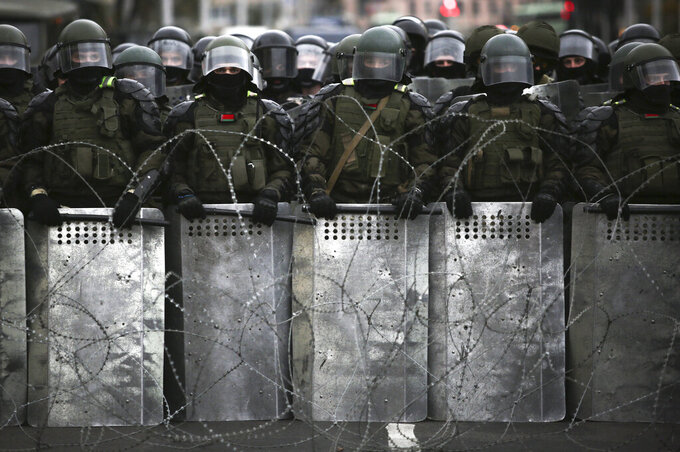 FILE - In this Sunday, Oct. 25, 2020 file photo, Belarusian police block a street during an opposition rally to protest the official presidential election results in Minsk, Belarus. Belarus President Alexander Lukashenko has relied on massive arrests and intimidation tactics to hold on to power despite nearly three months of protests sparked by his re-election to a sixth term, but continuing protests have cast an unprecedented challenge to his 26-year rule. (AP Photo, File)