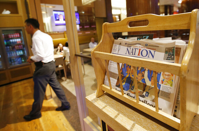 Thailand's English newspaper The Nation is displayed in a cafe in a hotel in Bangkok, Thailand, Thursday, May 16, 2019. The management of The Nation - founded in 1971 and one of Thailand's two English language dailies _ said that due to falling revenues, the publication of the printed paper edition of the newspaper will cease by the end of June, but it will continue to be published only online. (AP Photo/Sakchai Lalit)