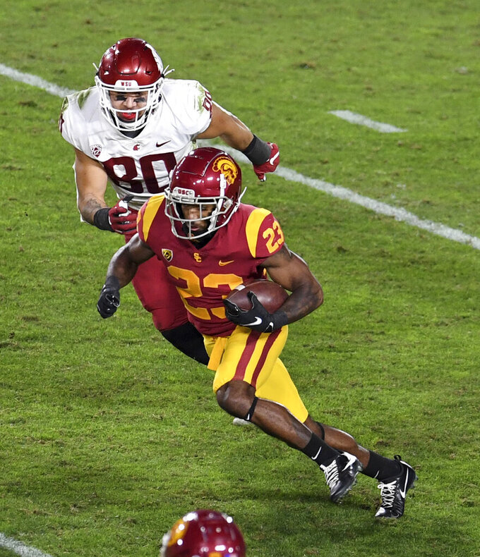 Southern California running back Kenan Christon (23) runs for a first down past Washington State defensive end Brennan Jackson (80) in the first half of an NCAA college football game in Los Angeles, Sunday, Dec. 6, 2020. (Keith Birmingham/The Orange County Register via AP)
