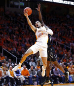 Tennessee guard Lamonte Turner (1) goes for a shot as he's fouled by Vanderbilt guard Maxwell Evans during the first half of an NCAA college basketball game Tuesday, Feb. 19, 2019, in Knoxville, Tenn. (AP photo/Wade Payne)