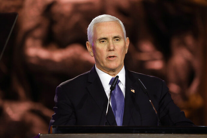 U.S. Vice President Mike Pence speaks during the World Holocaust Forum in Jerusalem, Thursday, Jan. 23, 2020.   Pence, Russian President Vladimir Putin,  French President Emmanuel Macron, Britain's Prince Charles, and the presidents of Germany, Italy and Austria were among the more than 40 dignitaries attending the World Holocaust Forum, which coincides with the 75th anniversary of the liberation of the Auschwitz death camp.  (Abir Sultan/Pool Photo via AP)