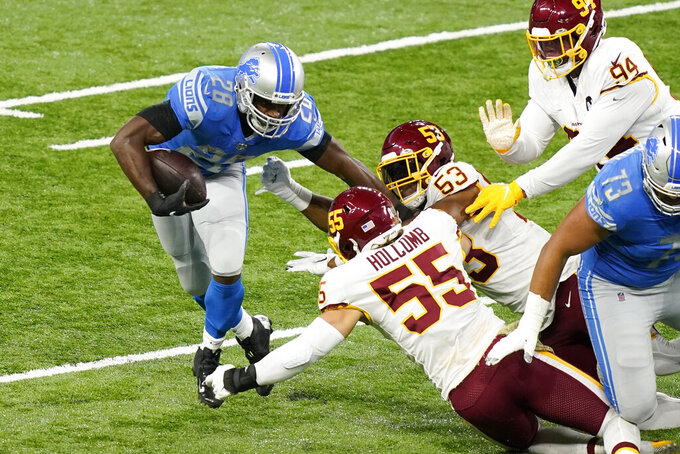 Detroit Lions running back Adrian Peterson (28) rushes during the first half of an NFL football game against the Washington Football Team, Sunday, Nov. 15, 2020, in Detroit. (AP Photo/Carlos Osorio)