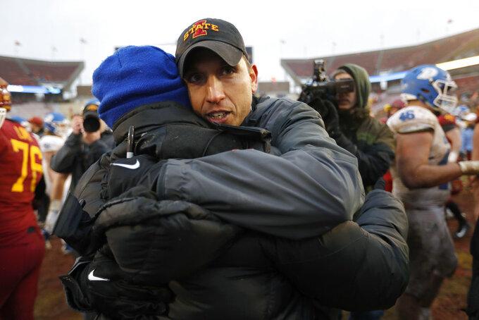 Drake head coach Rick Fox, left, gets a hug from Iowa State head coach Matt Campbell after an NCAA college football game, Saturday, Dec. 1, 2018, in Ames, Iowa. Iowa State won 27-24. (AP Photo/Charlie Neibergall)