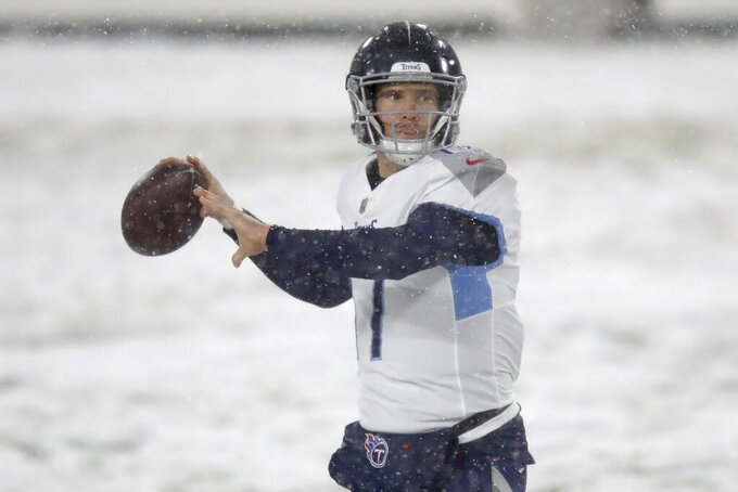 Tennessee Titans' Ryan Tannehill warms up before an NFL football game against the Green Bay Packers Sunday, Dec. 27, 2020, in Green Bay, Wis. (AP Photo/Matt Ludtke)