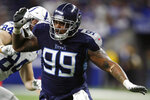 FILE - In this Dec. 1, 2019, file photo, Tennessee Titans defensive end Jurrell Casey (99) rushes in against the Indianapolis Colts during an NFL football game in Indianapolis. The Denver Broncos have acquired five-time Pro Bowl defensive lineman Jurrell Casey from the Tennessee Titans. Two people familiar with the trade tell The Associated Press that the Titans swapped Casey to Denver for a seventh-round draft pick. The move cannot become official until the new league year begins later Wednesday, March 18, 2020, though most teams won't announce official signings until players pass physicals to finalize deals. (AP Photo/Jeff Haynes, File)
