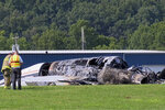 "The burned remains of a plane that was carrying NASCAR television analyst and former driver Dale Earnhardt Jr. lies near a runway Thursday, Aug. 15, 2019, in Elizabethton, Tenn. Officials said the Cessna Citation rolled off the end of a runway and caught fire after landing at Elizabethton Municipal Airport. Earnhardt's sister, Kelley Earnhardt Miller, tweeted that ""everyone is safe and has been taken to the hospital for further evaluation."" (WJHL TV via AP)"