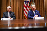 President Donald Trump speaks during a roundtable about America's seniors, in the Cabinet Room of the White House, Monday, June 15, 2020, in Washington, as Vice President Mike Pence listens. (AP Photo/Evan Vucci)