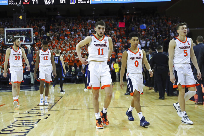 Virginia players leave the court after losing 81-71 to Duke during an NCAA college basketball game Saturday, Feb. 9, 2019, in Charlottesville, Va. (AP Photo/Zack Wajsgras)
