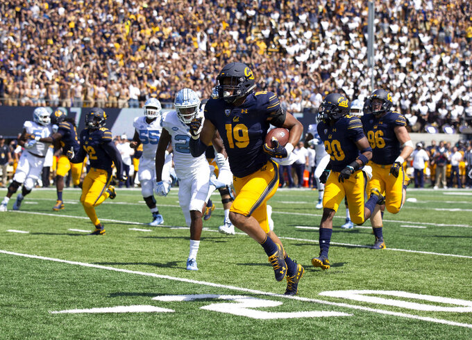 California linebacker Cameron Goode (19) runs back an interception of a pass by North Carolina quarterback Nathan Elliott for a touchdown during the first half of an NCAA college football game, Saturday, Sept. 1, 2018, in Berkeley, Calif. (AP Photo/D. Ross Cameron)