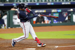 Atlanta Braves' Travis d'Arnaud (16) hits a broken bat single in the second inning in Game 3 of a baseball National League Division Series against the Miami Marlins, Thursday, Oct. 8, 2020, in Houston. (AP Photo/Eric Gay)