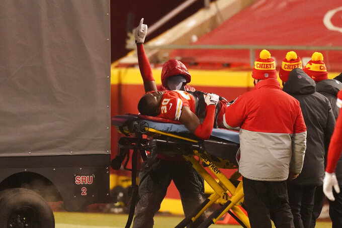 Kansas City Chiefs cornerback DeAndre Baker (30) is helped off the field after getting injured during the second half of an NFL football game against the Los Angeles Chargers, Sunday, Jan. 3, 2021, in Kansas City. (AP Photo/Charlie Riedel)