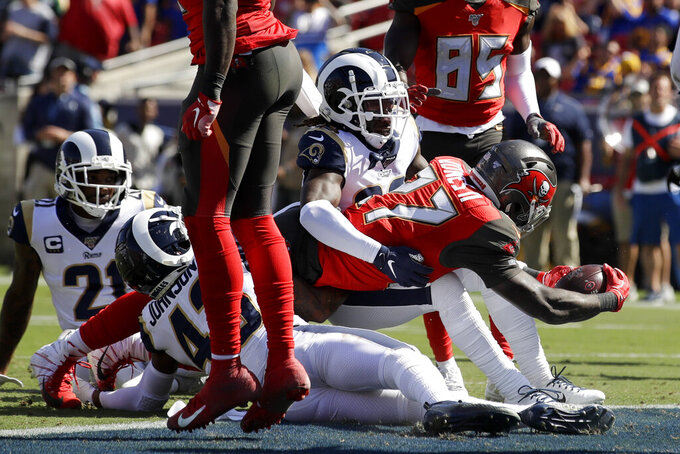 Tampa Bay Buccaneers running back Ronald Jones scores against the Los Angeles Rams during the first of an NFL football game Sunday, Sept. 29, 2019, in Los Angeles. (AP Photo/Marcio Jose Sanchez)
