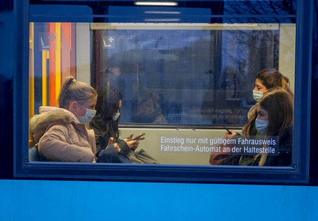 Passengers wear face masks as they sit in a subway in Frankfurt, Germany, Wednesday, Oct. 28, 2020. (AP Photo/Michael Probst)