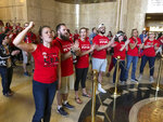 Protesters inside the Oregon State Capitol shout their support for Oregon schools to be fully funded, Wednesday, May 8, 2019 in Salem, Ore. Tens of thousands of teachers across Oregon walked off the job Wednesday to demand more money for schools, holding signs and wearing red shirts that have become synonymous with a nationwide movement pushing lawmakers to better fund education. (AP Photo/Andrew Selsky)