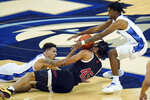 Creighton's Christian Bishop, left, Nebraska's Dalano Banton (45) and Creighton's Shereef Mitchell (4) go after a loose ball during the first half of an NCAA college basketball game in Omaha, Neb., Friday, Dec. 11, 2020. (AP Photo/Nati Harnik)