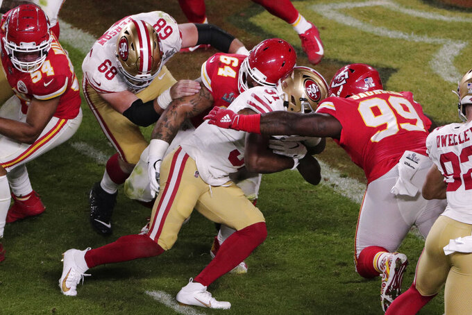 San Francisco 49ers' Raheem Mostert (31) runs for a touchdown, during the second half of the NFL Super Bowl 54 football game against the Kansas City Chiefs', Sunday, Feb. 2, 2020, in Miami Gardens, Fla. (AP Photo/Charlie Riedel)