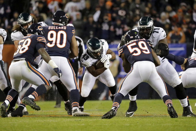 Philadelphia Eagles running back Darren Sproles (43) runs against Chicago Bears defenders during the second half of an NFL wild-card playoff football game Sunday, Jan. 6, 2019, in Chicago. (AP Photo/Nam Y. Huh)