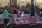 Actors perform Tazieh, a traditional play re-enacting the death of Hussein, the grandson of Prophet Muhammad and 72 of his companions, a day ahead of Ashoura, in downtown Tehran, Iran, Monday, Sept. 9, 2019. Ashoura falls on the 10th day of Muharram, the first month of the Islamic calendar, when Shiites mark the death of Hussein, at the Battle of Karbala in present-day Iraq in the 7th century. (AP Photo/Vahid Salemi)