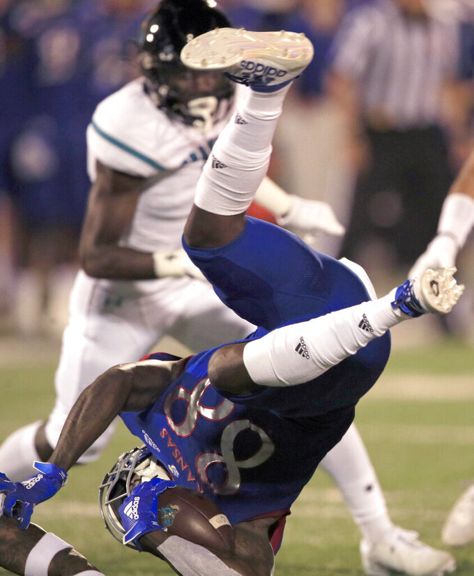 Kansas kick returner Jamahl Horne (88) is upended by Coastal Carolina defender Mallory Claybourne during the second half of an NCAA college football game in Lawrence, Kan., Saturday, Sept. 7, 2019. (AP Photo/Orlin Wagner)