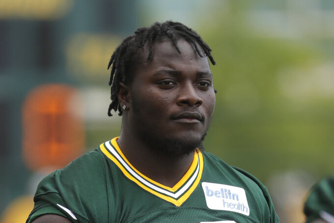 FILE - In this July 26, 2018, file photo, Green Bay Packers' Montravius Adams is seen during NFL football training camp in Green Bay, Wis. Packers defensive lineman Montravius Adams was arrested in Georgia this week and charged with marijuana and driving offenses. He was stopped Tuesday, May 18, 2020, just after 6 p.m. on suspicion of driving with suspended registration and no insurance, according to a Houston County Sheriff's Office report. (AP Photo/Morry Gash, File)