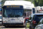 SMTD buses stage to move people cleared from buildings during an active shooter situation at the Bunn-O-Matic warehouse on Stevenson Drive, Friday, June 26, 2020, in Springfield, Ill. Police say officers are searching for a gunman at a warehouse in the Illinois state capital after at least one person was shot and wounded. (Justin L. Fowler/The State Journal-Register via AP)