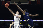 Virginia forward Sam Hauser (10) shoots during an NCAA college basketball game against Notre Dame Wednesday, Jan. 13, 2021, in Charlottesville, Va. (Erin Edgerton/The Daily Progress via AP, Pool)