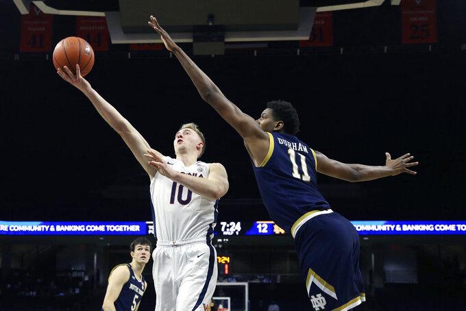 Virginia forward Sam Hauser (10) shoots during an NCAA college basketball game against Notre Dame Wednesday, Jan. 13, 2021, in Charlottesville, Va. (Erin Edgerton/The Daily Progress via AP, Pool)