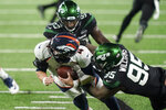 New York Jets defensive tackle Quinnen Williams (95) grabs the face mask of Denver Broncos quarterback Brett Rypien (4) during the second half of an NFL football game Thursday, Oct. 1, 2020, in East Rutherford, N.J. Williams was called for a penalty. (AP Photo/John Minchillo)