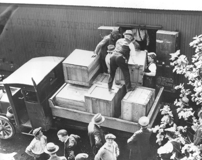 FILE - In this May 15, 1929, file photo authorities unload cases of whiskey crates labeled as green tomatoes from a refrigerator car in the Washington yards. The grower's express cargo train was en route from Holandale, Fla., to Newark, N.J. Statistically, Prohibition was not an utter failure. Deaths from alcohol-related cirrhosis declined, as did arrests for public drunkenness. What the statistics don't measure is how extensively Prohibition was flouted. Bootleggers established vast distribution networks. (AP Photo, File)