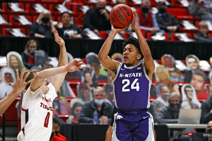 Kansas State's Nijel Pack (24) shoots over Texas Tech's Mac McClung (0) during the first half of an NCAA college basketball game Tuesday, Jan. 5, 2021, in Lubbock, Texas. (AP Photo/Brad Tollefson)