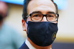 Treasury Secretary Steven Mnuchin wears a face mask as he arrives for a House Financial Services Committee hearing about the government's emergency aid to the economy in response to the coronavirus on Capitol Hill in Washington on Tuesday, Sept. 22, 2020. (Joshua Roberts/Pool via AP)