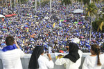 FILE - In this April 28, 2018 file photo, thousands of people congregate outside Managua's Cathedral during a