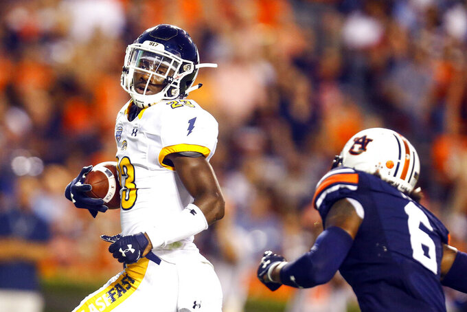 Kent State wide receiver Isaiah McKoy (23) catches a pass for a touchdown over Auburn defensive back Christian Tutt (6) during the first half of an NCAA college football game Saturday, Sept. 14, 2019, in Auburn, Ala. (AP Photo/Butch Dill)